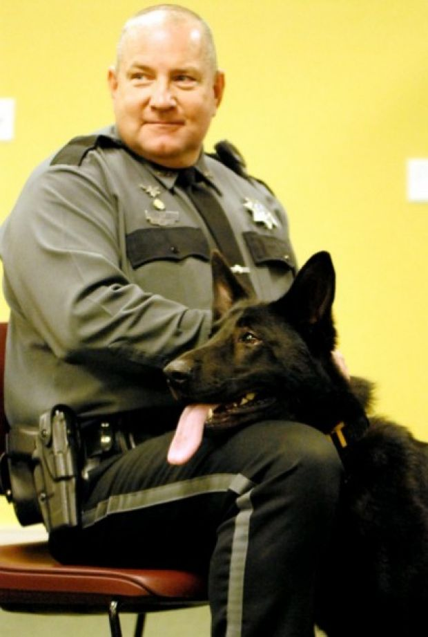Officer Ken Fuller and MPD's new K-9, Anson Photo by Cody Evans, The Ledger Independent