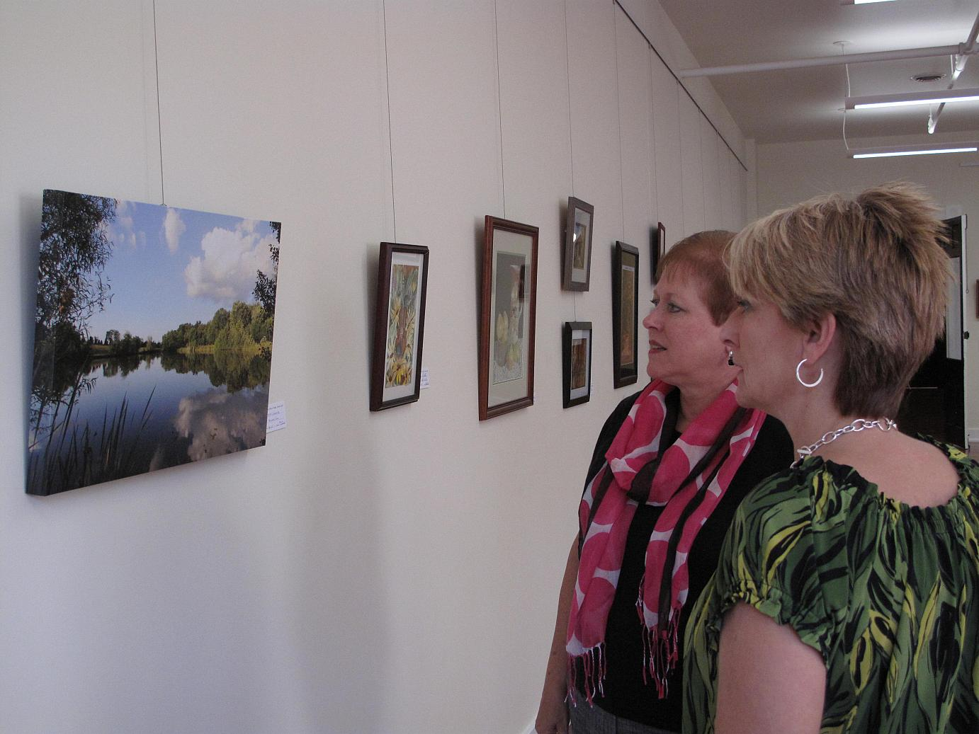 ORVAG - Guests viewing artwork at the Cox Building gallery.  New exhibits are highlighted every month.