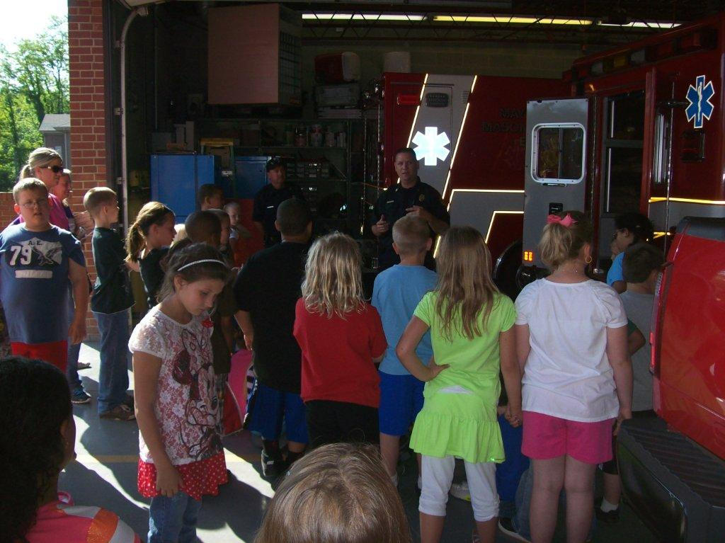 Lt. Dwayne Rice giving a tour to a group of children.